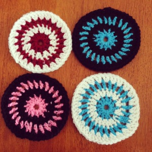 Multi-coloured crochet coasters